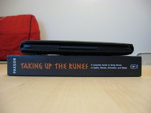 Photo of Kindle compared to print book.