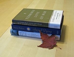 Pile of books with maple leaf