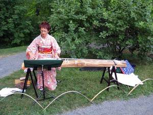Koto player in the Japanese garden.