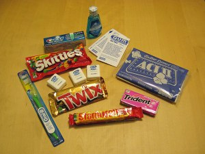 Candies, toothpaste, toothbrush, floss.